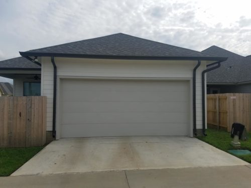 Garage view of home in Abbeville with seamless gutters