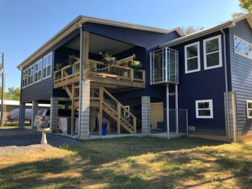 side angle view of 2 story camp with seamless gutters - located in Port Barre
